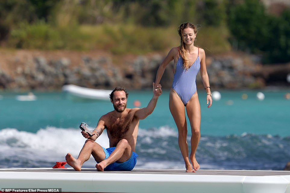 Thursday saw James girlfriend do away with her bikinis instead favouring a one piece in a blue stripey nautical style