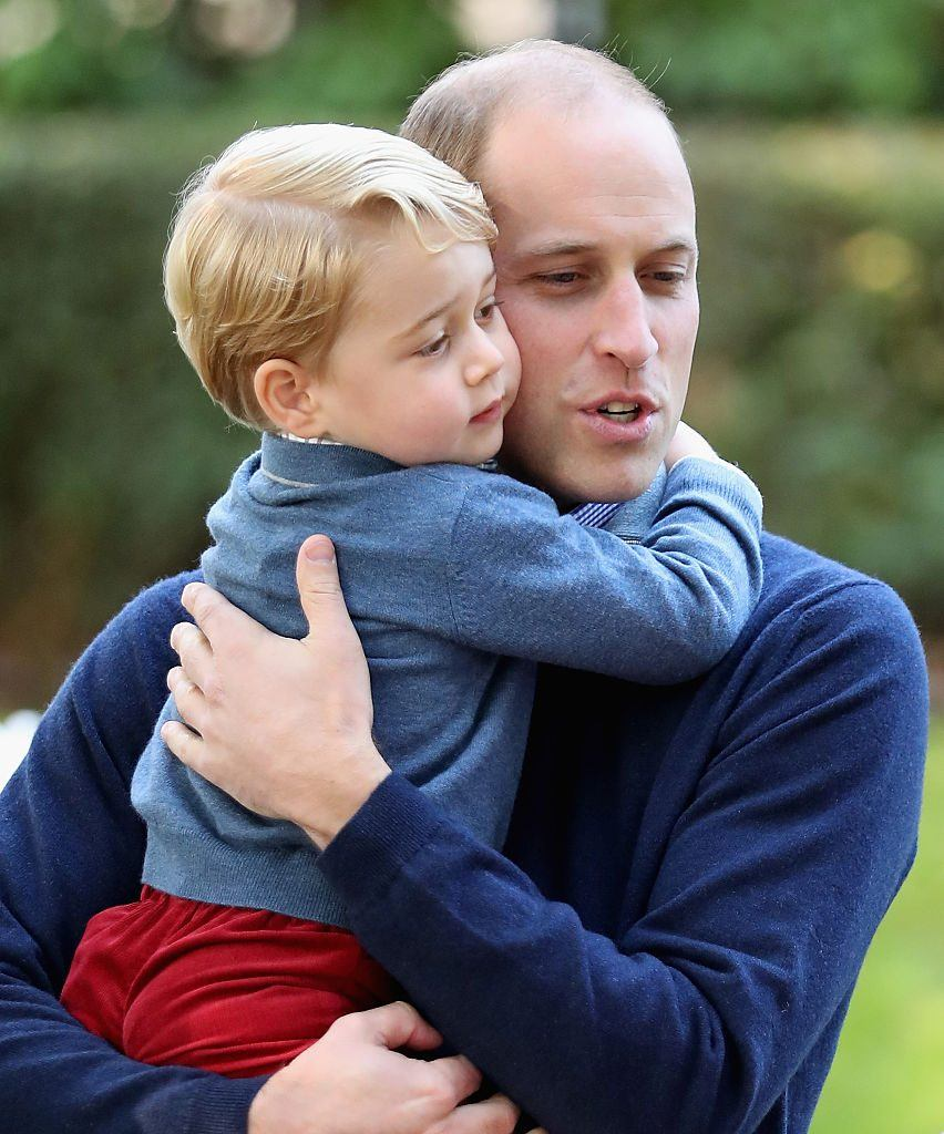 Prince George of Cambridge with Prince William, Duke of Cambridge at a children