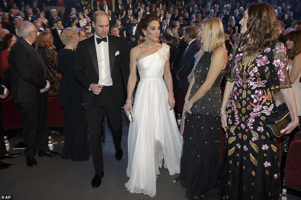 Heads turned as William and Kate entered the hall Looking every inch the film star alongside her husband Prince William