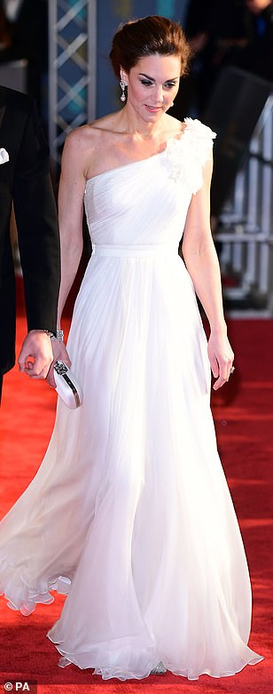 Holding a small matching white clutch the Duchess sported a glamorous makeup vibe with a pink lipstick and a dark smokey eye as she beamed for the cameras