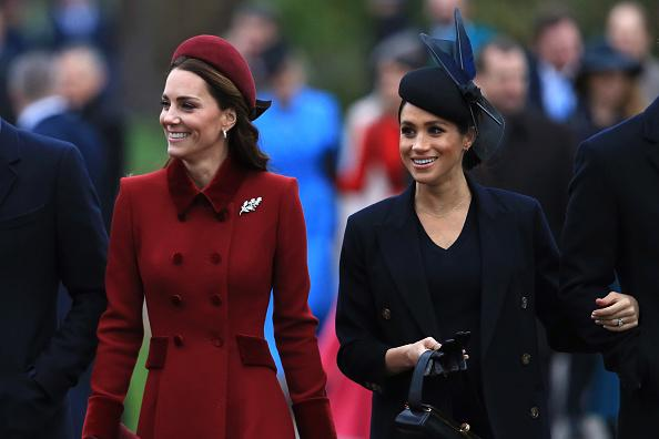 Kate Middleton and Princess Diana holding their baby bump photos resurface while Meghan Markle gets unfair criticism for doing the same Photo C GETTY IMAGES