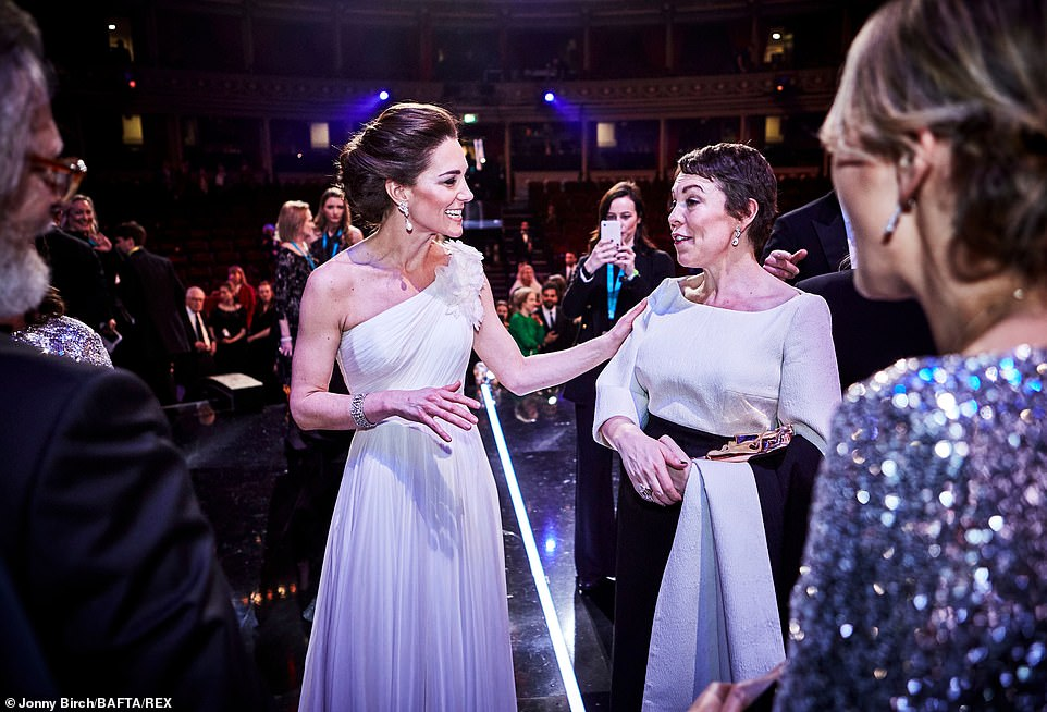 Kate and Olivia share a tender exchange on stage Adding an extra dose of glitz to her glamorous cinched waist ensemble