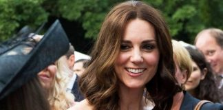 Kate stunned in the same red dress she wore to a party in Image GETTY
