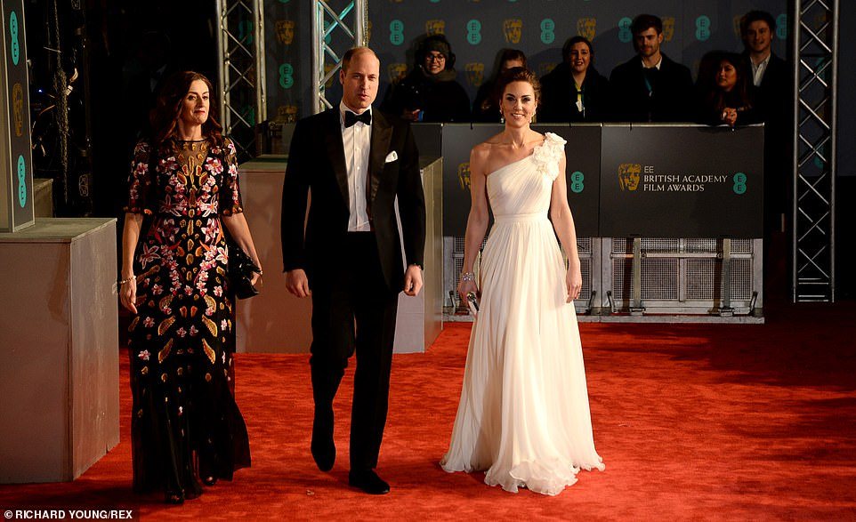 Kates stunning Alexander McQueen gown pictured on the red carpet with William is a bespoke number