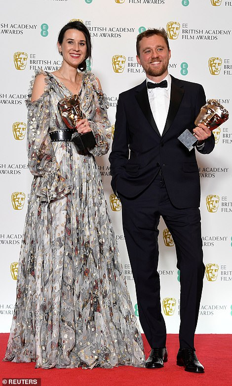 Lauren Dark and Michael Pearce hold their awards for Outstanding Debut by a British Writer Director or Producer