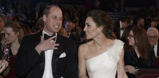 Leading the A list stars Kate wore a stunning Alexander McQueen off the shoulder white gown for her appearance alongside her husband Prince William