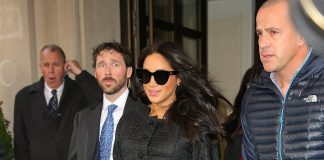 Meghan Markle was seen cradling her baby bump as she left the New York hotel where her baby shower is thought to be taking place shortly after her guests began arriving