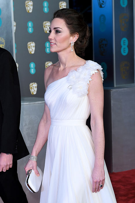 The Duchess looked incredible in a one shouldered white gown by her go to designer Alexander McQueen Photo C GETTY IMAGES