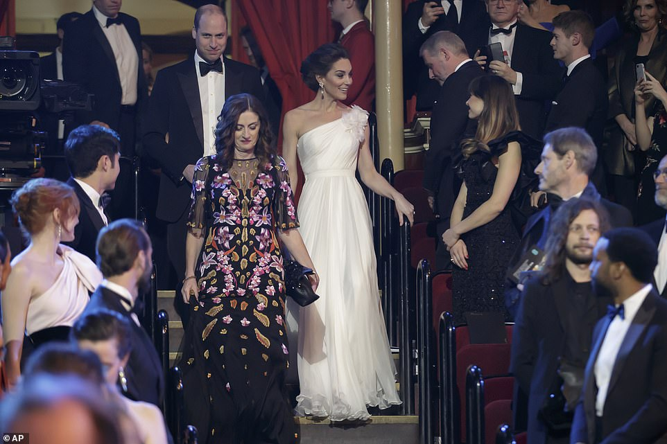 The Duke and Duchess of Cambridge are shown to their seats by BAFTA chief executive Amanda Berry