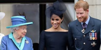 The Queen smiles with Prince Harry and Meghan Markle at the RAF centenary last year Image Getty