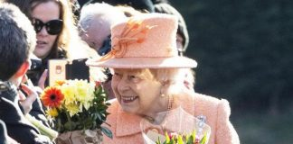 The Queen was presented with flowers as she stopped to greet members of the public Image GETTY