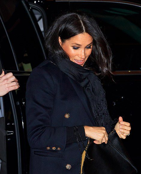 The pregnant duchess wore the same £ navy Victoria Beckham coat that she was seen in on Monday night when she was picture