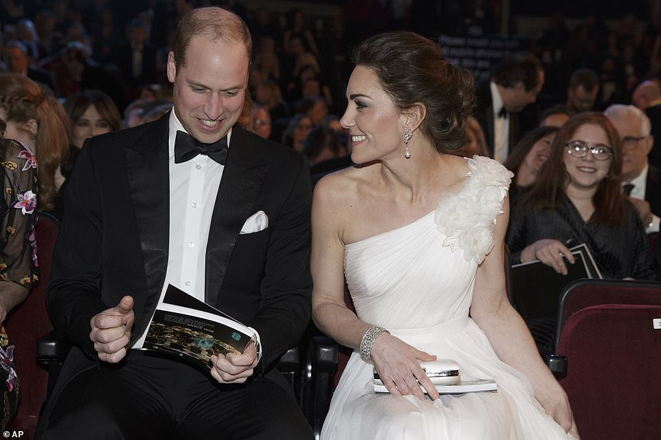 The royal couple looked as happy as ever as they beamed at one another when taking their seats in The Royal Albert Hall