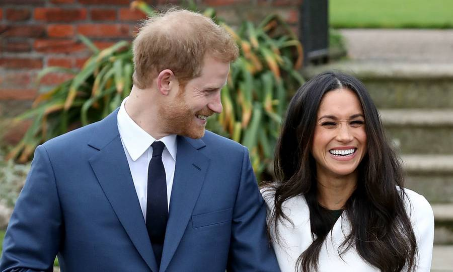 The sweet moment Prince Harry was caught looking lovingly at wife Meghans baby bump