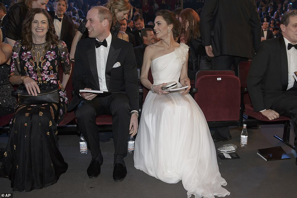 William and Kate chat excitedly before the show gets underway Adding an extra dose of glitz to her glamorous cinched waist ensemble