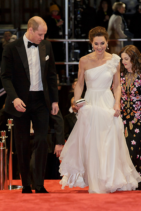 William cast a watchful eye over Kate as she walked up the steps in her Jimmy Choo heels Photo C GETTY IMAGES