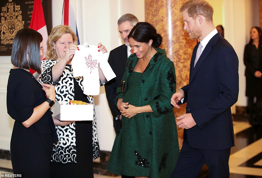 A gift for Baby Sussex Canadian High Commissioner to the United Kingdom Janice Charette second left presents Harry and Meghan