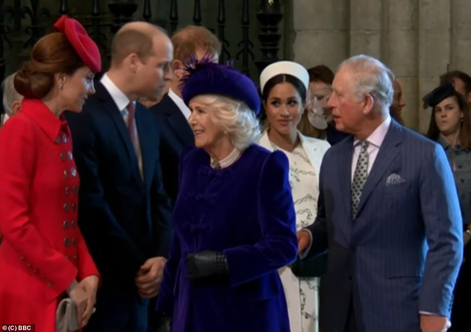 As Prince William engaged in conversation with the Prince of Wales Meghan watched on as Kate and Camilla also exchanged words inside the Abbey