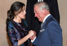 As the pair welcomed each other Prince Charles laughed and took Queen Letizias hand