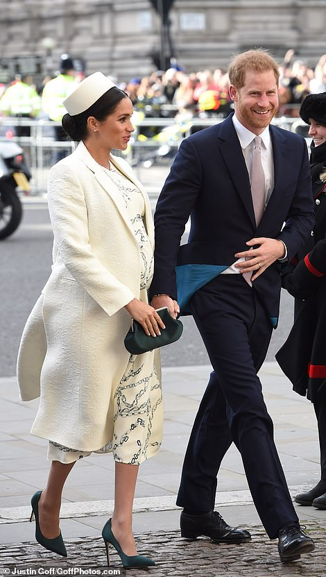 Bumping along nicely Meghan showcased her baby bump in a cream dress by Victoria Beckham