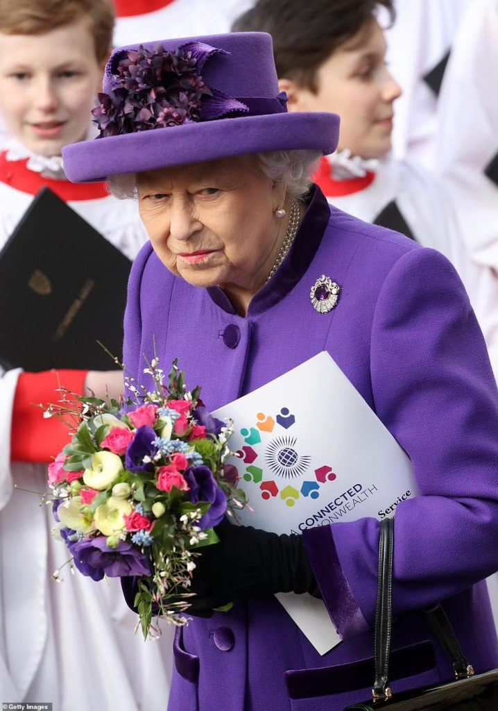 Donning a black pair of black velvet gloves the Queen clasped a bright bouquet and the order of service book as she leftthe service this afternoon