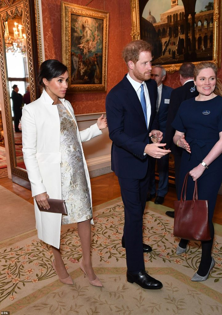 Duke and Duchess of Sussex at a reception at Buckingham Palace in London to mark the fiftieth anniversary of the investiture of the Prince of Wales