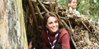During her visit Kate played with the children giggling as she hid with one of the children in a den that they had made outside with sticks and leaves