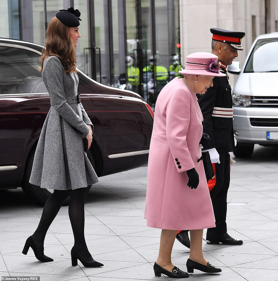 Following protocol the Duchess of Cambridge walked behind the Queen as they made their way into Bush House