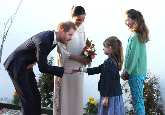 Harry and Meghan were a hit with children during their recent trip to Morocco photo C getty images