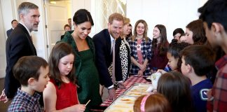 Harry and Meghan who are expecting their first child meet young people who demonstrate a Canadian spring tradition of making maple taffy