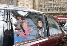 Kate Middleton and the Queen shared a blanket in the back of the car as they pulled up at Kings College London where they will reopen Grade II listed Bush House