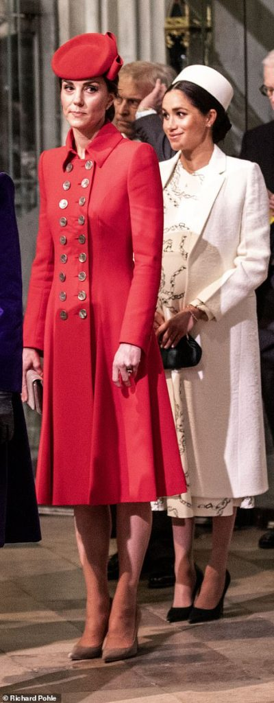 Kate accessorised her smart red for with a Gina Foster pillbox hat and wore her hair neatly tied back to prevent it blowing in the wind