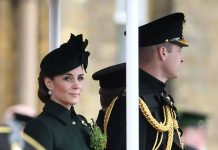 Kate chose to wear a custom green Alexander McQueen coat to visit the st Battalion Irish Guards at their base alongside husband Prince William Photo C REX