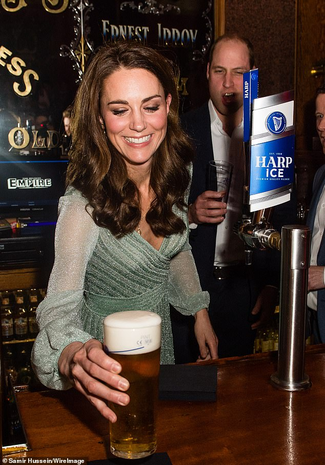 Kate opted for a designer gown when she joined her husband for a visit to Empire Music Hall Belfast last month Pictured the royal smiled as pulled a pint in the pub