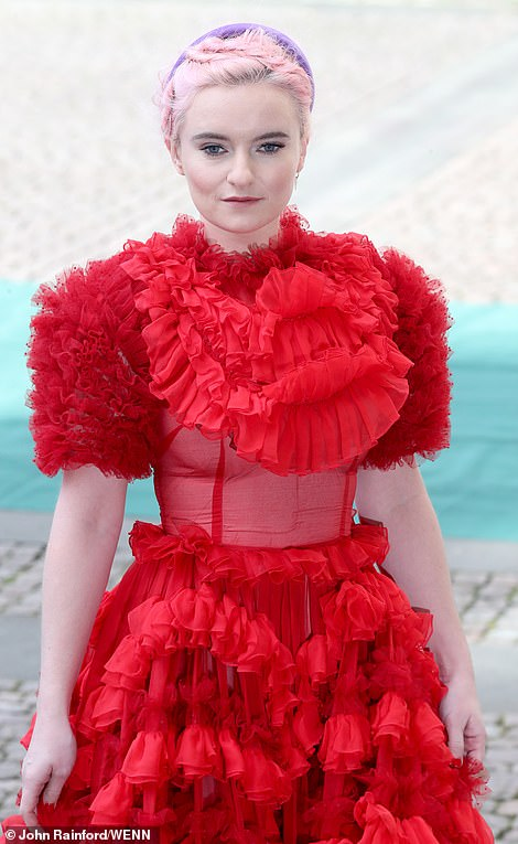 Lady in red Grace Chatto the cellist for Clean Bandit was joined by other band members Jack and Luke Patterson