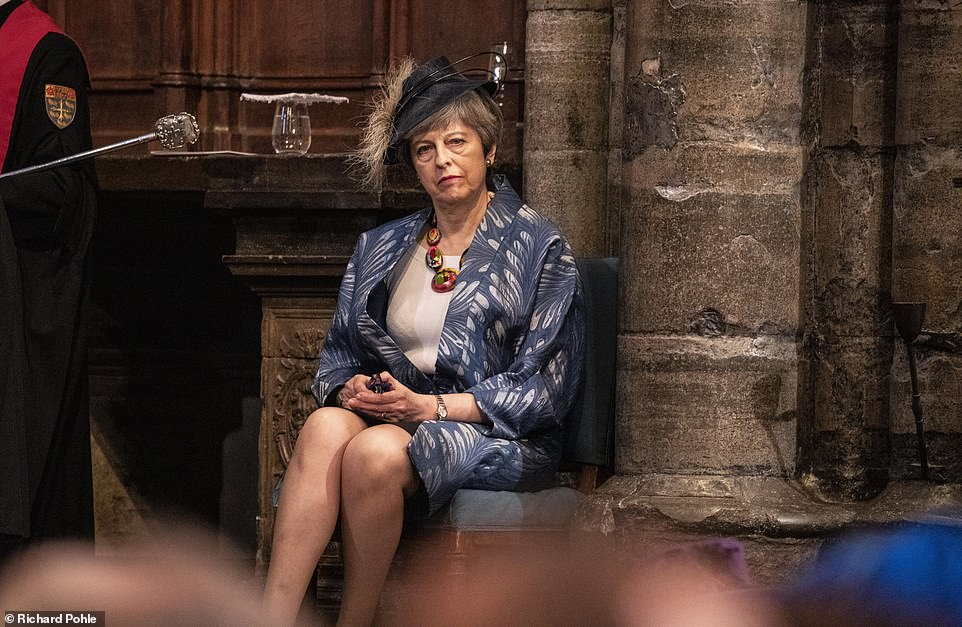 Lonely figure Prime Minister Theresa May waits to give a reading at the Westminster Abbey Commonwealth day service