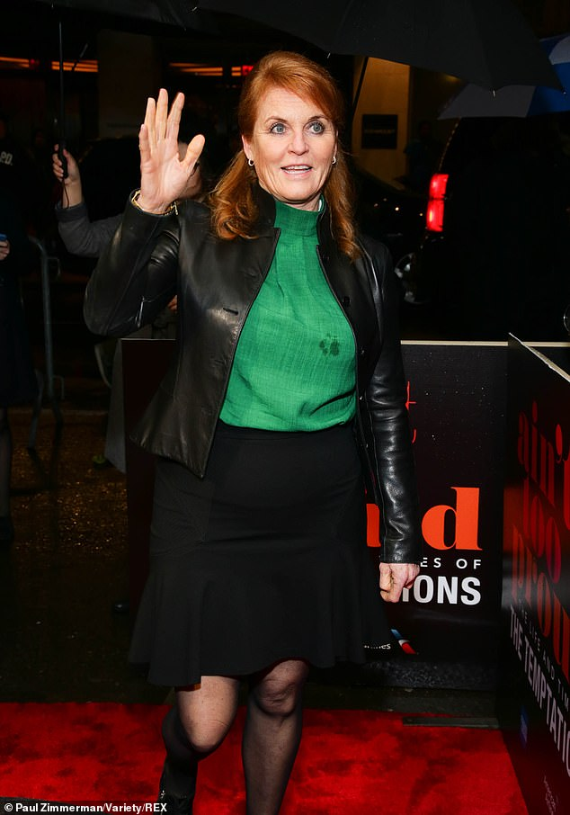 Not afraid to stand out from the crowds the mother of two donned a vibrant emerald green shell top that she teamed with a black peplum hem skirt