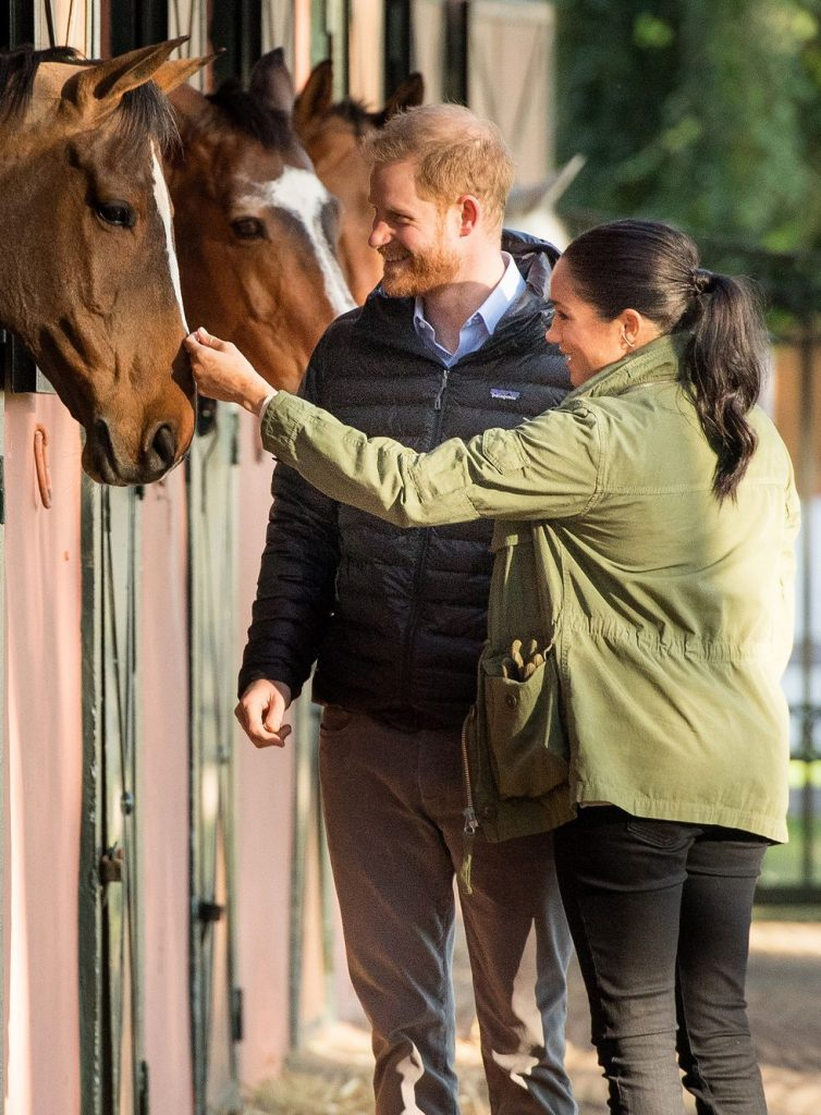 Photos of Queen Elizabeth Princess Diana and More Royal Family Members Hanging Out with Horses Photo C Getty Images