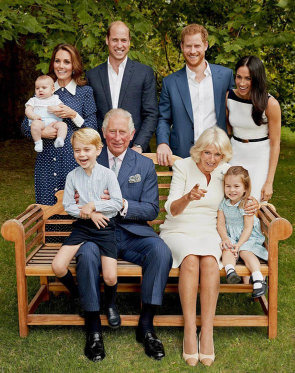 Prince Charles is pictured with a giggling Prince George on his knee Image PA