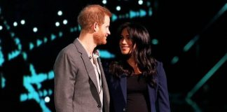 Prince Harry dragged pregnant wife Meghan Markle on stage today Pic Getty