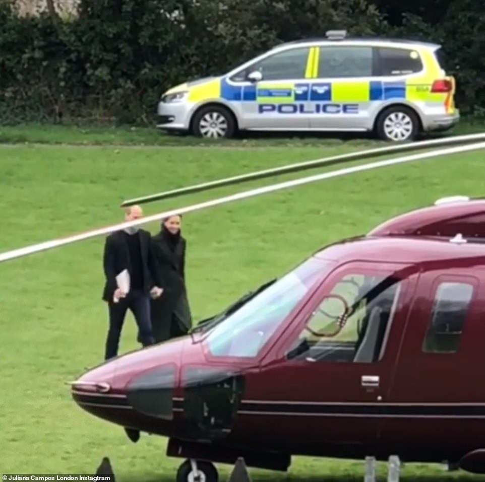 Shared by royal fan Juliana Campos from Londons Kensington Palace Gardens the video shows the Duke and Duchess of Cambridge smiling as they stroll to a waiting helicopter behind the palace