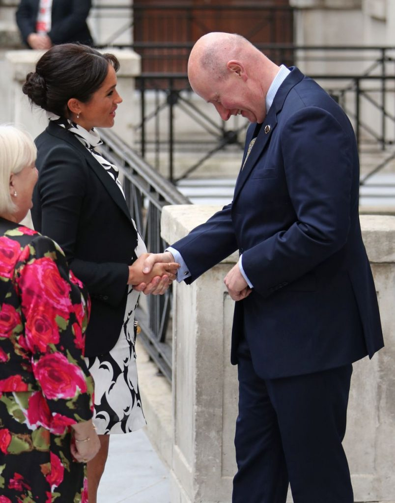 Sir Christopher greets pregnant Meghan on International Women's Day on March Photo C PAPRESS ASSOCIATION