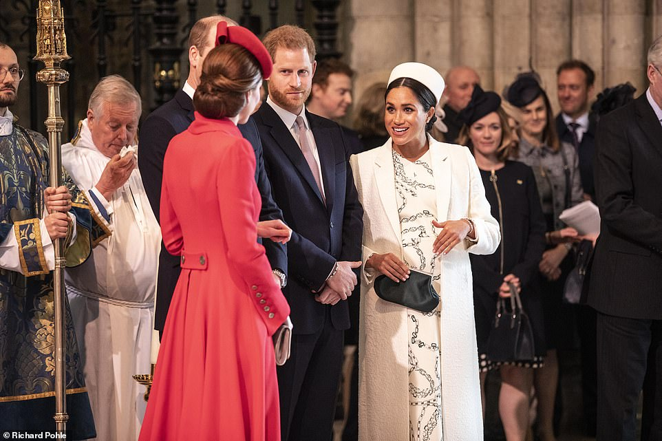 Stylish sisters in law Kate and Meghan both looked elegant in their designer ensembles and seemed to shrug off any hint of ill feeling as they engaged in a friendly chat