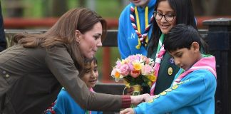 The Duchess of Cambridge arrives at the Scouts Headquarters in Gilwell Park as speaks to children as well as recieving flowers