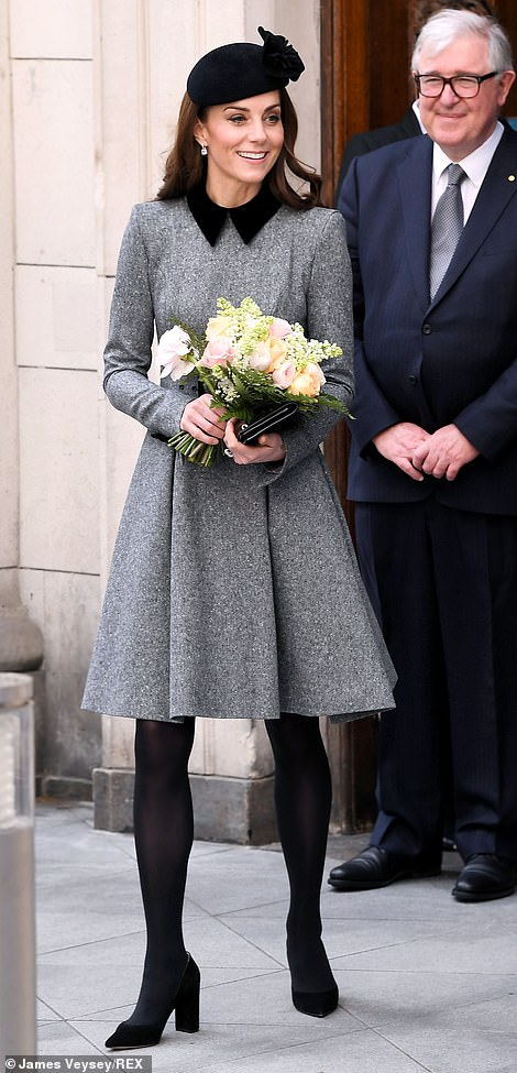 The Duchess of Cambridge carried a bouquet of pink white and orange blooms left and right as she left Bush House
