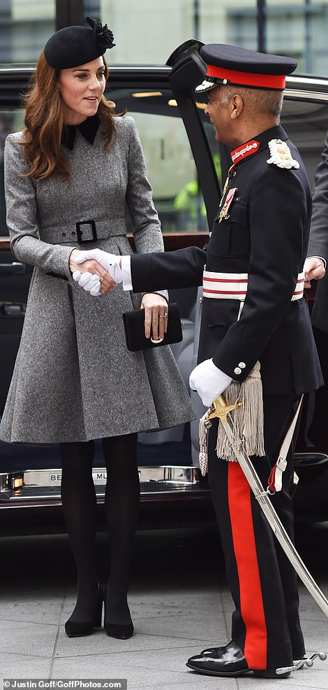 The Duchess of Cambridge looked elegant in a Catherine Walker coat black hat and black heels for the outing