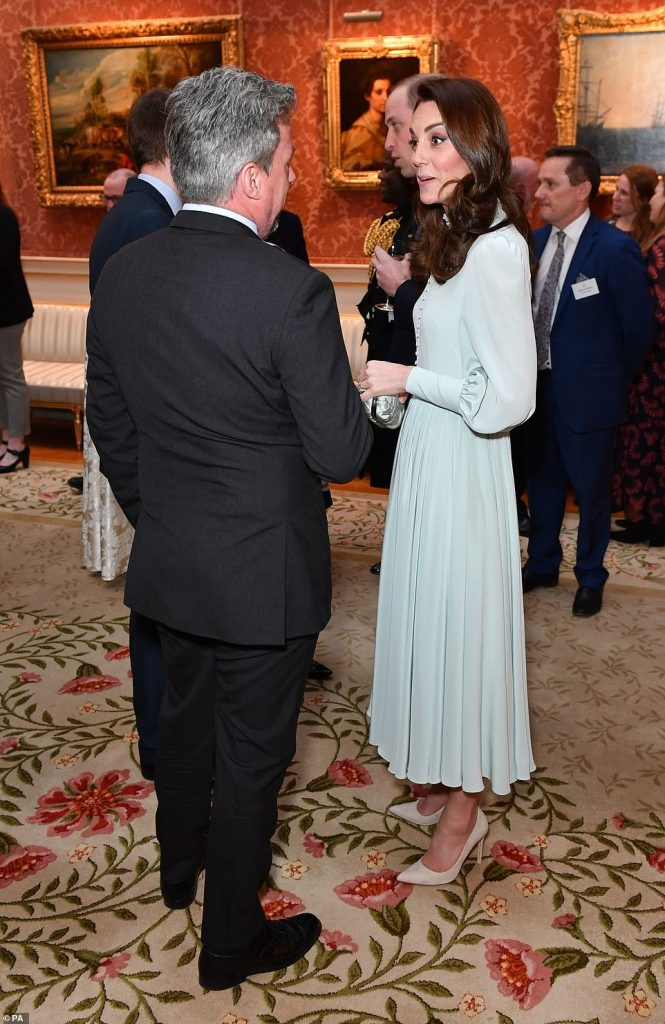 The Duchess of Cambridge looked stylish in a mint coloured blouse dress featuring ruffled sleeves and a button up collar teaming the frock with suede nude heels