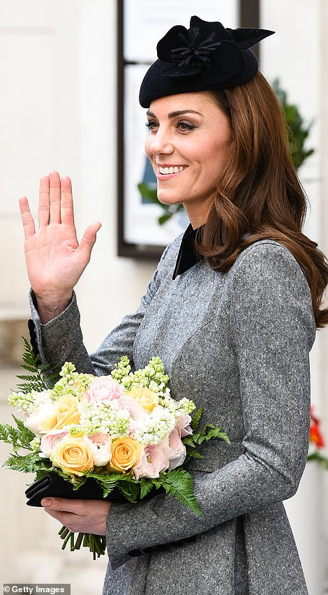The Duchess of Cambridge received a beautiful bouquet of flowers as she left Kings College London following the outing
