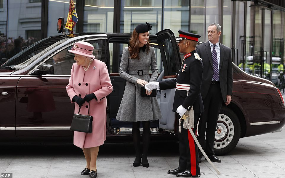 The Duchess of Cambridge smiled as she stepped out of the car while the Queen turned her attention to the well wishers