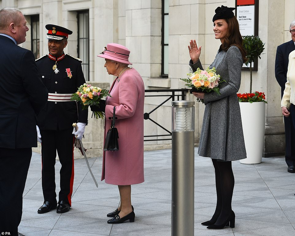 The Duchess of Cambridge waved as she followed the Queen out of Bush House Kings College London today